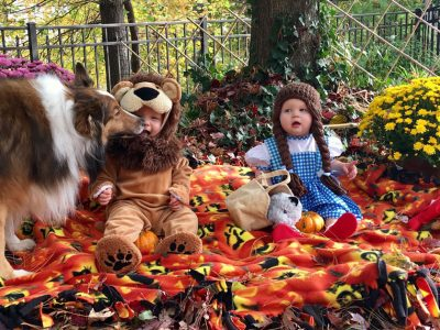 Sheltie kissing kids in costumes