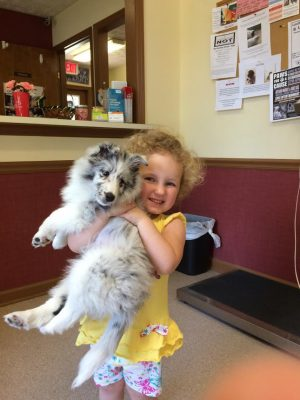 Girl and new puppy
